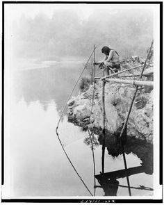 Fishing from a platform by Edward Curtis (Navajo)