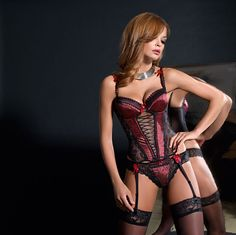 Presented in red and black, the Gaudi is an absolutely stunning and striking push up basque. Embossed with small black patterned streaks and criss cross design, the Gaudi is adorned with guipures and contrasting black lace panels with beautifully decorated straps. Garter straps are attached to the basque. Thong or briefs sold separately