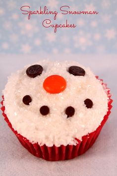 Super cute and easy Sparkling Snowman Cupcake White glitter sprinkles. Orange m&m. Mini choc chips. Mini oreos.