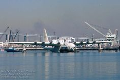 Howard Hughes' Flying Boat floating in Los Angeles Harbor. Worlds largest wooden airplane, flown only once. What a waste!