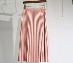 Fall is around the corner and classic style should be our year round choice. This pleated skirt is tailored in suede fabric with gathered details at the waistline on both sides. In midi length, this s
