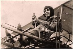 """Hélène Dutrieu, September, 1911. Dutrieu was known as the """"girl hawk"""" of aviation because she was the most daring and accomplished woman pilot of her time. In November, 1910, she became the first Belgian woman to receive a pilot license. She went on to set many records. In 1913, the French government awarded her the Legion of Honor for her achievements. Here she is pictured at the controls of her Farman (Henry) 1910 Baby. NASM-73-4023"""
