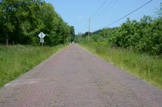The Old Red Brick Road is a historical landmark in Redmond, part of an early 20th century highway that stretched from Seattle to Boston.