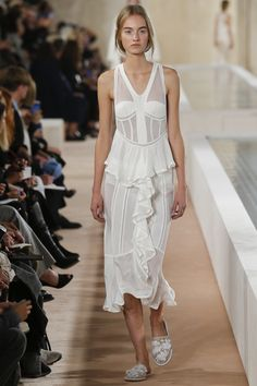 Balenciaga Spring 2016 White in all glory, from the ruffled slip dresses to the low-slung trousers and crop top pairings, and all combined with white lace slippers with floral embellishments. #PFW