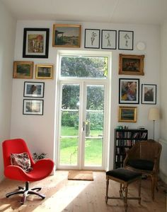 eclectic living room Eclectic Swedish Country House  Aside from the VERY BARE and OPEN window / door (it needs some shades!), I like the dispersal of framed pictures.