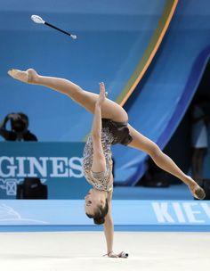 Ganna Rizatdinova of Ukraine perform with the batons during the 32nd rhythmic gymnastics world championships in Kiev, Ukraine, Thursday, Aug. 29, 2013