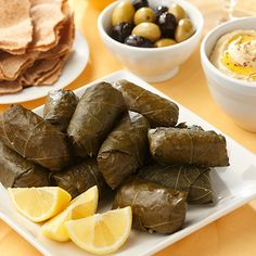 Lamb and Rice Stuffed Grape Leaves~~learned to make these from the Lebanese w/ ground round steak...very excellent to eat cold w/ lots of lemon juice