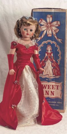 """""""Sweet Ann"""" in Red Satin Gown 30"""" (78 cm). Vinyl socket head,sleep eyes,closed mouth,long tosca rooted hair (with original hair net),five-piece hard plastic body,wearing original red satin gown,with white taffeta insert and silver metallic lace overlay,floral trim,elaborate rhinestone tiara,pearl choker,brooch and earrings,panties,sling heels with rhinestone trim. Excellent condition,some red color running onto white part of gown. Deluxe Reading,circa 1950's,with vivid complexion and…"""
