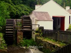 Water wheel and barn house at the Ulster Folk and Transport Museum, Cultra, County Down, near Belfast, Northern Ireland.