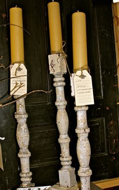 old porch spindle posts used as candle holders
