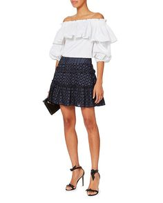 Alexis Antonina Dot Skirt: Playful dots and cutout tonal floral eyelets mix together on this charming mini skirt. Flared hem. Covered elasticized waist band. Lined. In navy. Fabric: 100% viscose Lining: 50% cotton/47% nylon/3% spandex  Made in USA.    Model Measurements: Height ...