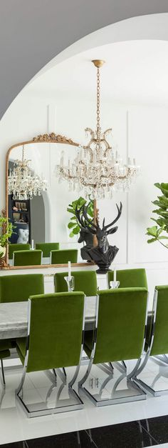 Dining room with bright green dining chairs.