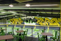 Jump Extreme trampoline centre – 40m hand-painted graffiti mural mixing different letter styles, transparent paint effects and bold graphical elements to complement the interior design. #graffiti #handpainted #sportsmural