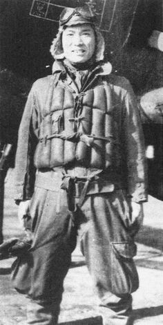Yoshio Nakamura of the 302nd Kōkūtai in front of a J2M raiden, 1944. Pin by Paolo Marzioli