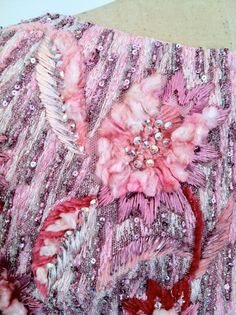 Detail of the embroidery of the PIERRE BALMAIN dress. Attributed to Maison Lesage, heavily crystal, metallic & silk chenille floral themed embroidered covered bodice....