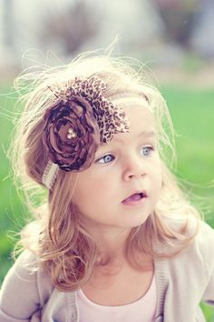 What a beautiful little girl, I love this hair piece.