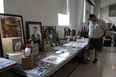 Roger Carter looks over some of the items at the Boys & Girls Club celebrity Auction held in August 2016 at Trinity United Methodist Church in Greeneville, Tennessee