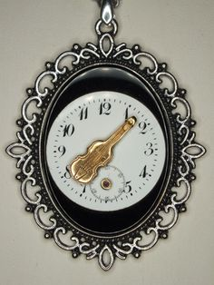 Onyx pendant with a brass violine on a pocket watch dial from the early 20th century. by Kupferdach Production