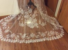Inspired by a an incredible circa 1890 hand embroidered veil, this 10 foot cathedral mantilla style veil features machine embroidered appliqué elements and rose embroideries. Will post this listing to my etsy shop shortly. Please convo me with any questions! Debbie www.etsy.com/shop/timeless weddingsshop