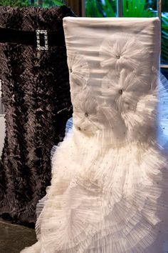 Perfect for the happy couple, and bride and groom chair cover from Resource One #black #white #wedding #chairs