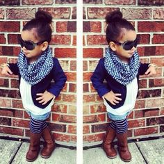 Kids childrens girls fashion style: white top, navy blue jacket, denim shorts, navy blue & white striped leggings stockings, brown leather boots