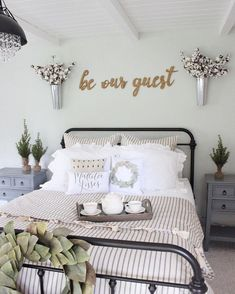 Farmhouse guest bedroom with rod iron bed from bedding from black crystal chandelier from and be our guest wood signs. Farmhouse Style Bedrooms, Farmhouse Master Bedroom, Country Farmhouse Decor, Farmhouse Style Decorating, Home Bedroom, Bedroom Furniture, Modern Farmhouse, Rustic Decor, Dream Bedroom