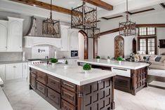 English Tudor | Portfolio | Sims Luxury Builders How To Make Building, Tudor Kitchen, Double Staircase, Narrow House, English Tudor, Tudor House, Curtain Patterns, Large Homes, Luxury Kitchens