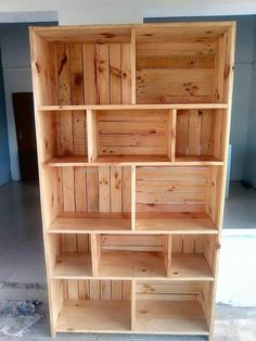 Have a look at the shelving cabinet; there are spaces of different sizes in it. You can see the boxes of different length and width to place the decorative items to make the area look appealing if the idea is copied for the TV launch.