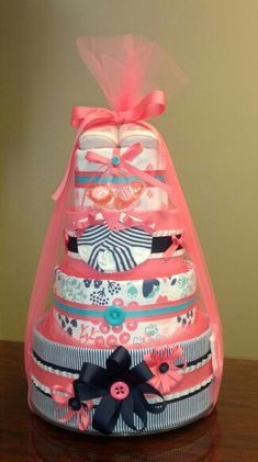 Baby girl diaper cake, baby shower gift, navy and coral. Check out Simply Showers Facebook page for more photos and orders. https://m.facebook.com/adorablegifts