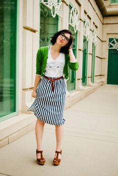 Nerdy nerderson. Striped skirt, bright green cardigan, printed tee, and wedges.