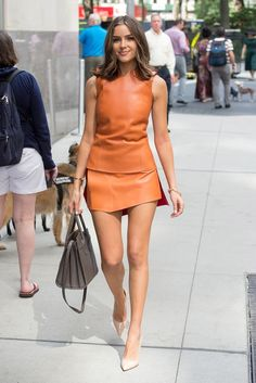 Olivia Culpo wears an orange leather top and a .- Olivia Culpo wears an orange leather top and skirt with a # girl # school # school # spring # 2019 # casual # juveniles # boy # men # cute # fashion - New York Fashion, Fashion Mode, Fashion Week, Look Fashion, Fashion Outfits, Womens Fashion, Fashion Trends, Net Fashion, Fashion Ideas