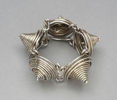 West African Inspired Bracelet    Alexander Calder.  'Cone'  c 1940. Gilded silver