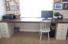 2 file cabinets + 1 plank = best DIY desk ever