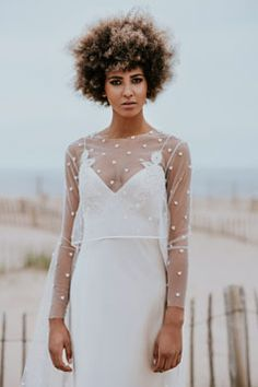 Grace Bungoni looking stunning in the David Fielden Gown, Kathryn Trueman, Morpeth. Paired with the fine Thousand Hearts Veil Top by Poppy Dover. Ring from Rozu Jewellery.