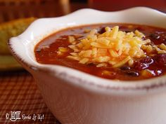Taco Soup ~ 1 pound ground beef  1 onion  salt and pepper  3  14.5 oz cans Mexican Stewed Tomatoes  2  15 oz cans black beans  2  15 oz cans kidney beans  2  15 oz cans corn  1  8 oz can tomato sauce  1  6 oz can tomato paste  1 fajita, or taco seasoning packet  1 lime  4 T maple syrup  2 C water