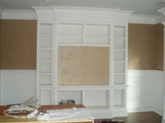 entertainment center built in- ceiling to floor, but not wall to wall