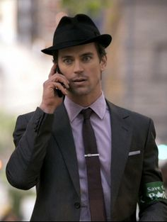 I've noticed that guys wearing hats is starting to come into style again, but only Neil Caffrey could make a fedora look so good!
