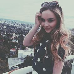 Sabrina Carpenter – and her hilltop view – look so stunning in her latest Instagram picture. The Girl Meets World star showed off her pretty hair, retro-inspired Wildfox sunglasses and cute floral top in the beautiful photo.