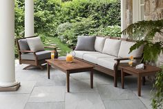 Wood furniture is a beautiful contrast against outdoor greenery | 52 Designer Patio Ideas