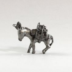 This listing is for the pewter figurine of a donkey shown in the photos. The figurine measures 1 1/4 nose to tail and 1 tall. I have one more of