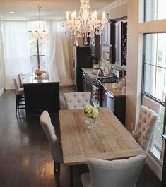 Dining Room decor ideas - rustic glam elegant style with neutral colors, farmstyle table, upholstered chairs and fancy crystal chandelier.