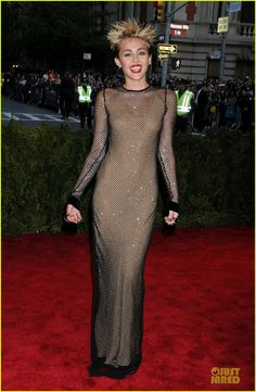 Miley Cyrus is a mesh beauty at the 2013 Met Gala held at the Metropolitan Museum of Art on Monday (May 6) in New York City.