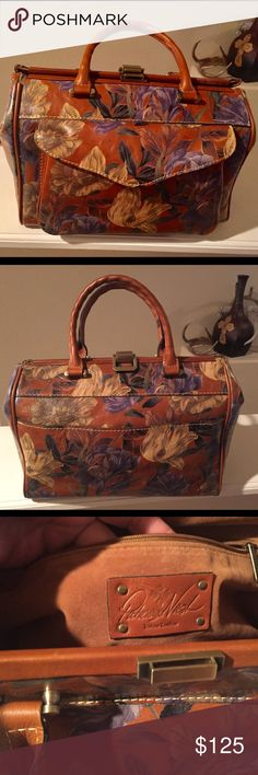 """NWOT!"""" PATRICIA NASH"""" DOCTOR BAG👜 From the """"Enlightened Garden"""" Collection this never worn purse displays beautiful flowers design on the leather. Brass hardware, one flap compartment on the front and one on the back.  Extremely roomy. Comes with shoulder strap and dust bag. It measures approximately 15""""x 12"""". No longer have the tag but it does have the certification/registration card. Patricia Nash Bags Shoulder Bags"""
