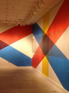 April 25, 2016: Sol LeWitt, Wall Drawing #618, 2014, bands of lines in four directions with color ink washes superimposed Courtesy of the Sol LeWitt Foundation. Asheville Art Museum.