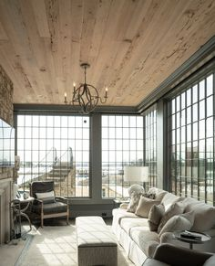 Can't you feel how warm and peaceful this sunroom is? Our Pecky Cypress Paneling balances out all the light from the windows with just the right amount of warmth. #paneling Commercial Interior Design, Commercial Interiors, Pecky Cypress Paneling, Reclaimed Wood Paneling, Sunroom, How Are You Feeling, Windows, Curtains, Warm