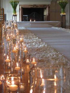 To give your wedding ceremony a more romantic and intimate feel, select clear-lit candles on both sides of the aisle, as well as white rose petals. If your wedding is during the winter and around the holiday time, then this decor is perfect for your ceremony.