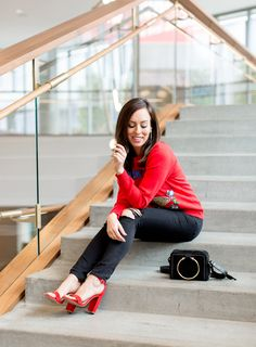 Sydne Style shows black and red outfit ideas for holiday season