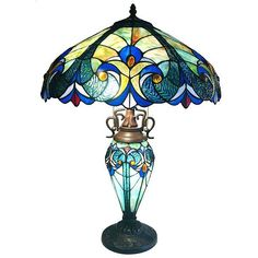 This table lamp features brilliant hues of beige, gold, green, blue and red in its Tiffany-style shade. The bronze finish adds warmth and Victorian charm to this light.