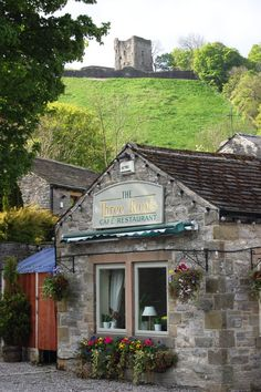 Three Roofs Café, Castleton, Derbyshire, in the Peaks District. (Peveril Castle shown to the back) Amazing little restaurant. We had fish and chips there with my husband's family. England And Scotland, England Uk, London England, Places To Travel, Places To Go, Travel Destinations, Castleton Derbyshire, Peak District, Cities