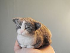 This cute kitty is a needle felted soft sculpture, created with careful attention to detail. Made of high quality wool. Lovely gift for any cat lover :)  Measures: its body lenght is 5 (13 cm). Material: high quality wool. 100% handmade.  Please note: a needle felted sculpture is not a toy. This lovely kitten is ready to ship. Thank you for looking